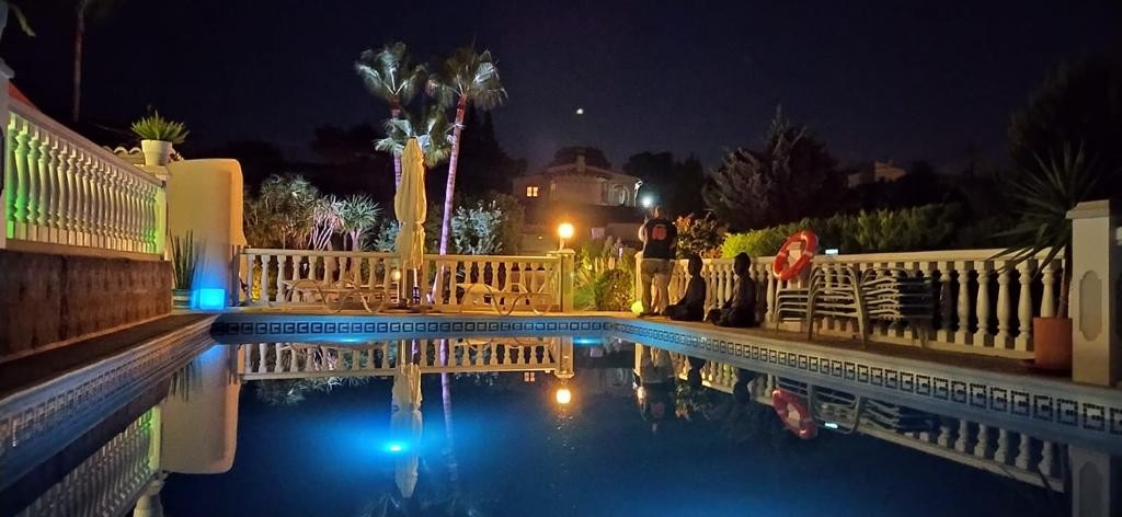 The pool area of Siete Palmeras is also an experience at night.