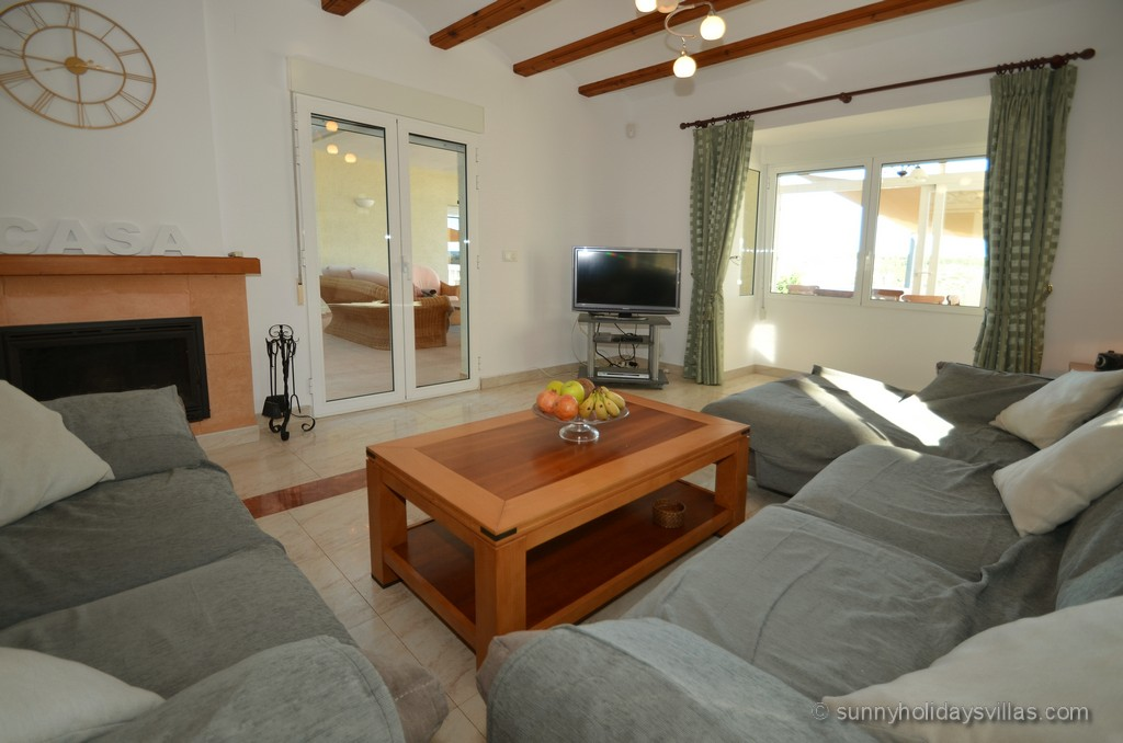 From the living room there you access the large, covered terrace and the pool.
