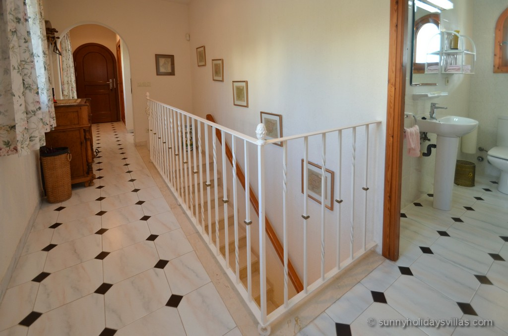 Inside staircase leading to the lower apartment with 3 bedrooms